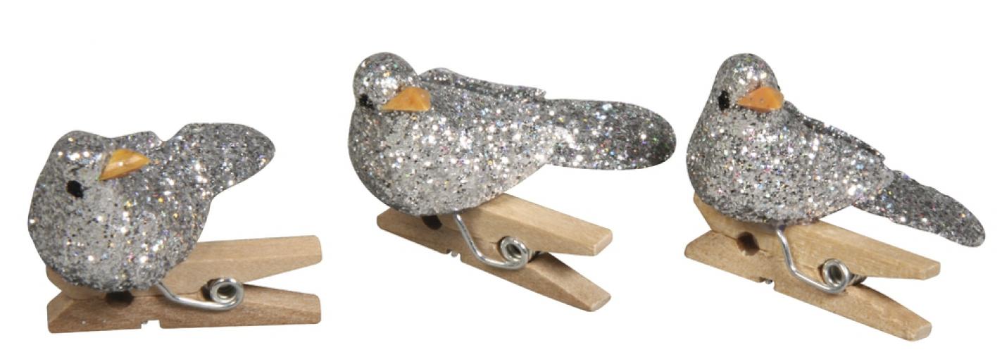Knijpers met zilveren vogeltjes