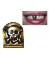 Gouden tand met doodshoofd